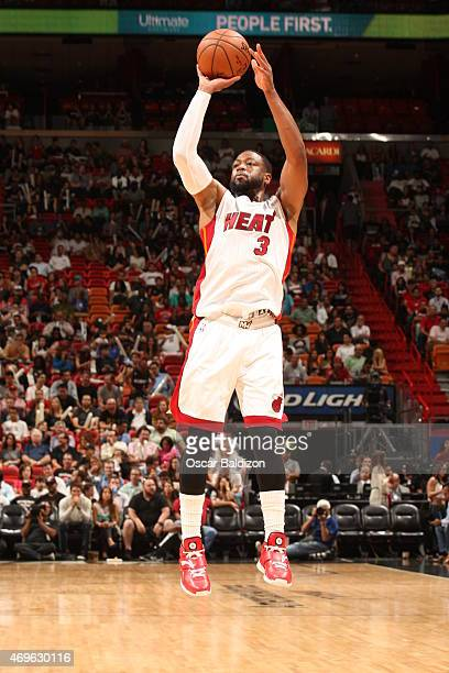 Dwyane Wade of the Miami Heat shoots against the Orlando Magic on April 13 2015 at American Airlines Arena in Miami Florida NOTE TO USER User...