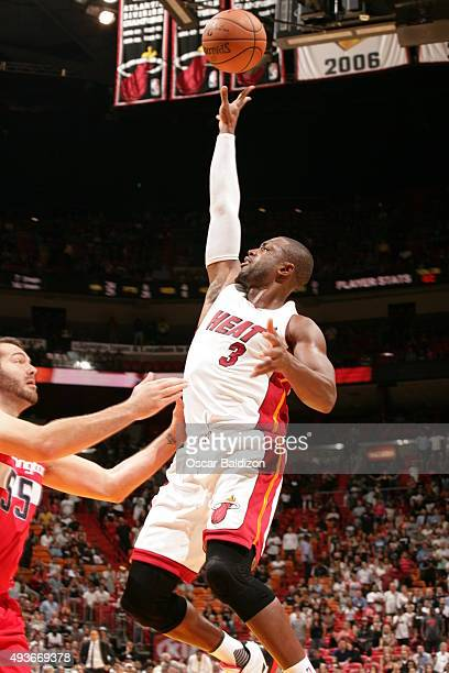 Dwyane Wade of the Miami Heat shoots against the Washington Wizards on October 21 2015 at AmericanAirlines Arena in Miami Florida NOTE TO USER User...