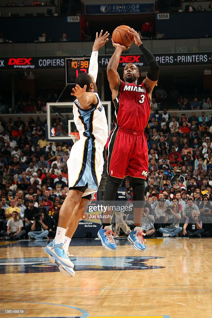 <a gi-track='captionPersonalityLinkClicked' href=/galleries/search?phrase=Dwyane+Wade&family=editorial&specificpeople=201481 ng-click='$event.stopPropagation()'>Dwyane Wade</a> #3 of the Miami Heat shoots against <a gi-track='captionPersonalityLinkClicked' href=/galleries/search?phrase=Wayne+Ellington&family=editorial&specificpeople=2351537 ng-click='$event.stopPropagation()'>Wayne Ellington</a> #3 of the Memphis Grizzlies on November 11, 2012 at FedExForum in Memphis, Tennessee.