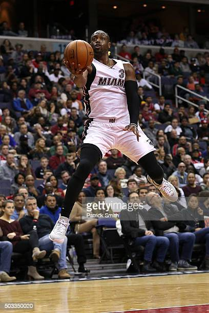 Dwyane Wade of the Miami Heat shoots at the buzzer in the second quarter against the Washington Wizards at Verizon Center on January 3 2016 in...