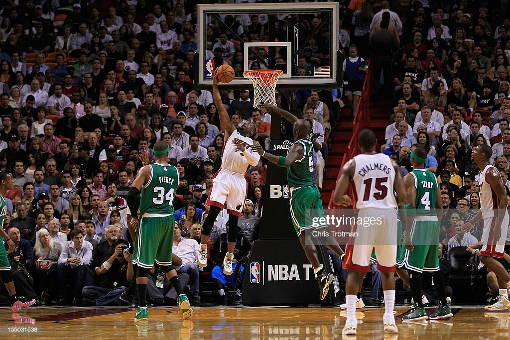 Dwyane Wade #3 of the Miami Heat shoots over Kevin Garnett #5 of the Boston Celtics at American Airlines Arena on October 30, 2012 in Miami, Florida.