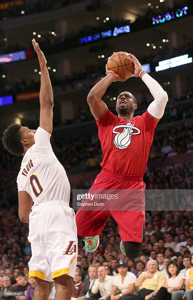 <a gi-track='captionPersonalityLinkClicked' href=/galleries/search?phrase=Dwyane+Wade&family=editorial&specificpeople=201481 ng-click='$event.stopPropagation()'>Dwyane Wade</a> #3 of the Miami Heat shoots over Nick Young #0 of the Los Angeles Lakers at Staples Center on December 25, 2013 in Los Angeles, California. The Heat won 101-95.