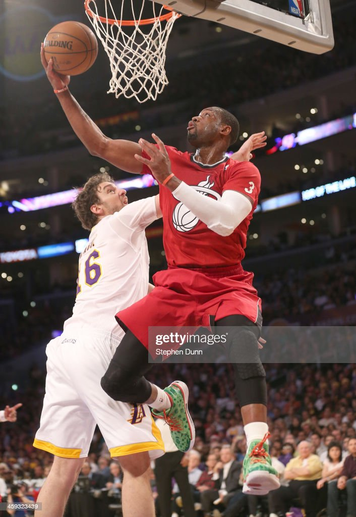 <a gi-track='captionPersonalityLinkClicked' href=/galleries/search?phrase=Dwyane+Wade&family=editorial&specificpeople=201481 ng-click='$event.stopPropagation()'>Dwyane Wade</a> #3 of the Miami Heat shoots over Pau Gasol #16 of the Los Angeles Lakers at Staples Center on December 25, 2013 in Los Angeles, California. The Heat won 101-95.