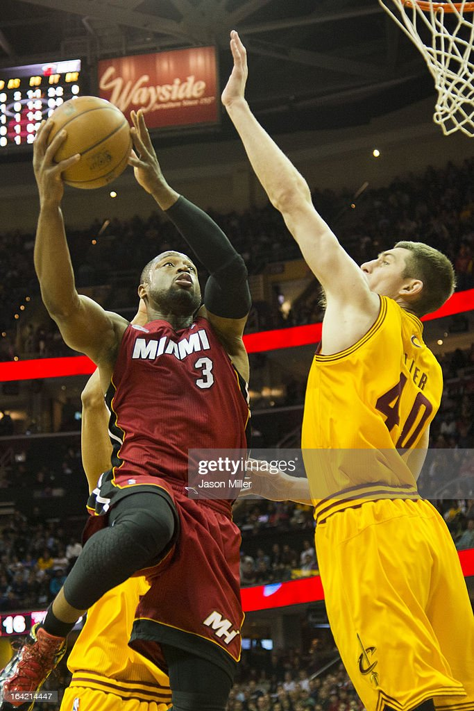 Dwyane Wade #3 of the Miami Heat shoots over Tyler Zeller #40 of the Cleveland Cavaliers during the first half at Quicken Loans Arena on March 20, 2013 in Cleveland, Ohio.