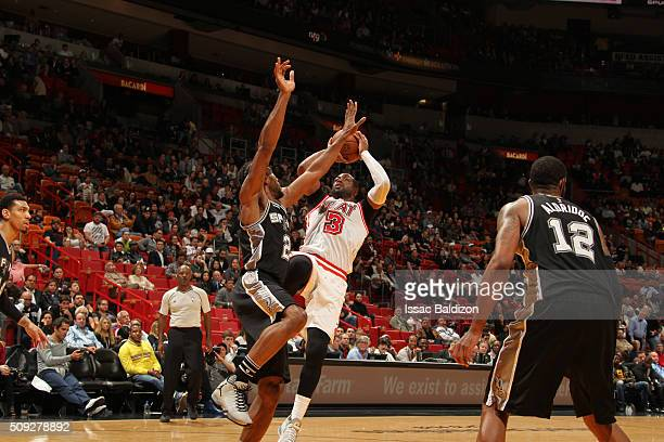 Dwyane Wade of the Miami Heat shoots the ball against Kawhi Leonard of the San Antonio Spurs on February 9 2016 at American Airlines Arena in Miami...