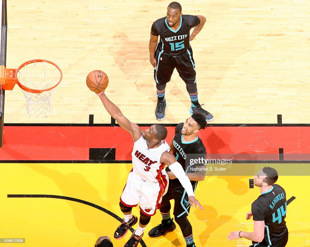 <a gi-track='captionPersonalityLinkClicked' href=/galleries/search?phrase=Dwyane+Wade&family=editorial&specificpeople=201481 ng-click='$event.stopPropagation()'>Dwyane Wade</a> #3 of the Miami Heat shoots the ball against the Charlotte Hornets in Game Seven of the Eastern Conference Quarterfinals during the 2016 NBA Playoffs on May 1, 2016 at American Airlines Arena in Miami, Florida.
