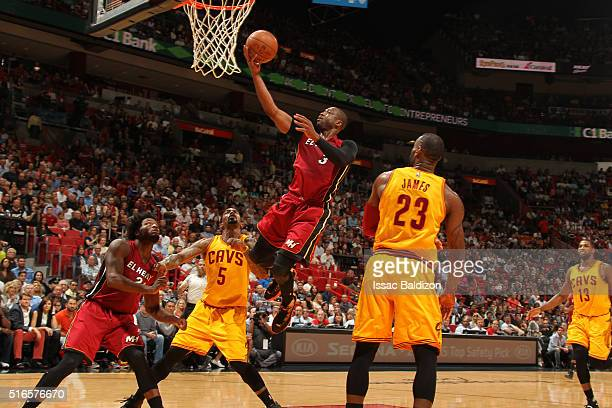 Dwyane Wade of the Miami Heat shoots the ball against the Cleveland Cavaliers on March 19 2016 at AmericanAirlines Arena in Miami Florida NOTE TO...