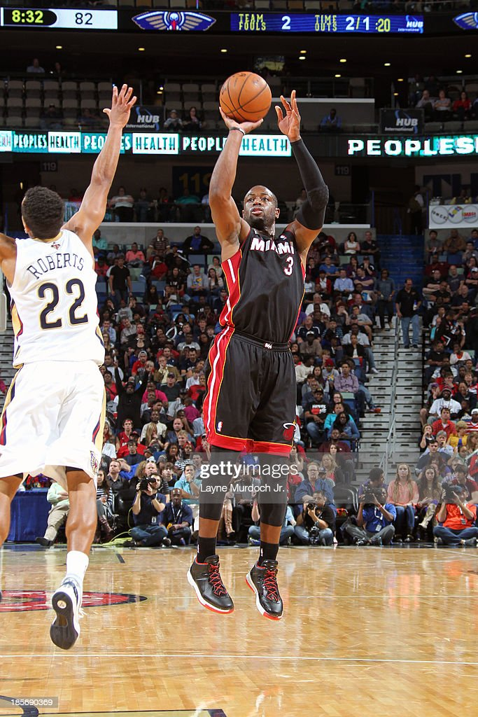 <a gi-track='captionPersonalityLinkClicked' href=/galleries/search?phrase=Dwyane+Wade&family=editorial&specificpeople=201481 ng-click='$event.stopPropagation()'>Dwyane Wade</a> #3 of the Miami Heat shoots the ball against the New Orleans Pelicans during an NBA preseason game on October 23,2013 at the New Orleans Arena in New Orleans, Louisiana.