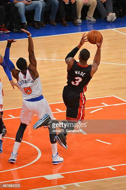 Dwyane Wade of the Miami Heat shoots the ball during the game against the New York Knicks on January 09 2014 at Madison Square Garden in New York...
