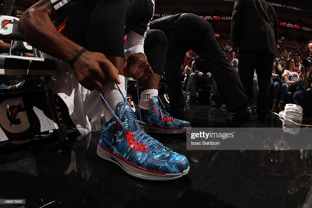 <a gi-track='captionPersonalityLinkClicked' href=/galleries/search?phrase=Dwyane+Wade&family=editorial&specificpeople=201481 ng-click='$event.stopPropagation()'>Dwyane Wade</a> #3 of the Miami Heat showcases his sneakers against the Boston Celtics on November 9, 2013 at American Airlines Arena in Miami, Florida.
