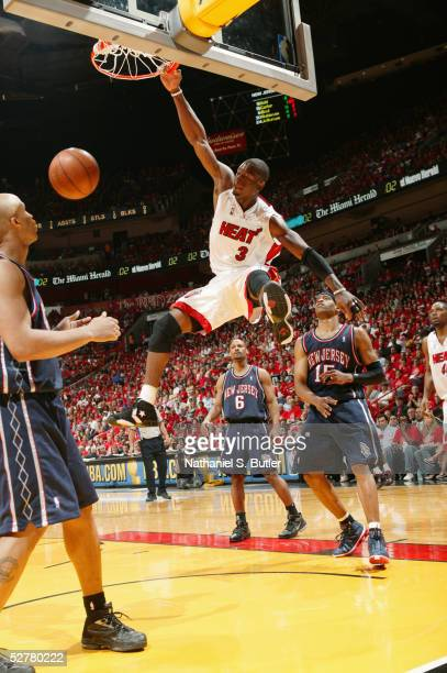 Dwyane Wade of the Miami Heat slam dunks against the New Jersey Nets in Game one of the Eastern Conference Quarterfinals during the 2005 NBA Playoffs...