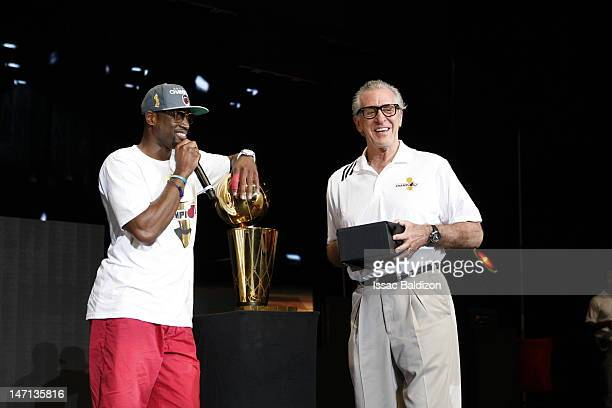 Dwyane Wade of the Miami Heat speaks on stage as the Miami Heat President Pat Riley looks on during a rally for the 2012 NBA Champions Miami Heat at...