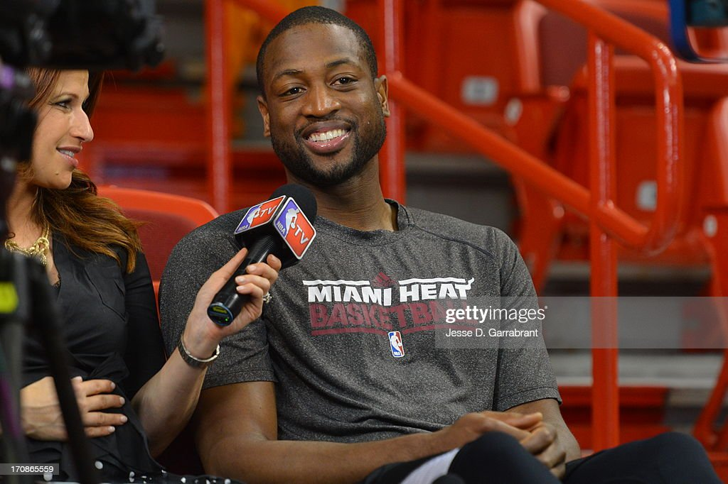 Dwyane Wade #3 of the Miami Heat speaks to Rachel Nichols of NBA TV during media availability as part of the 2013 NBA Finals on June 19, 2013 at American Airlines Arena in Miami, Florida.