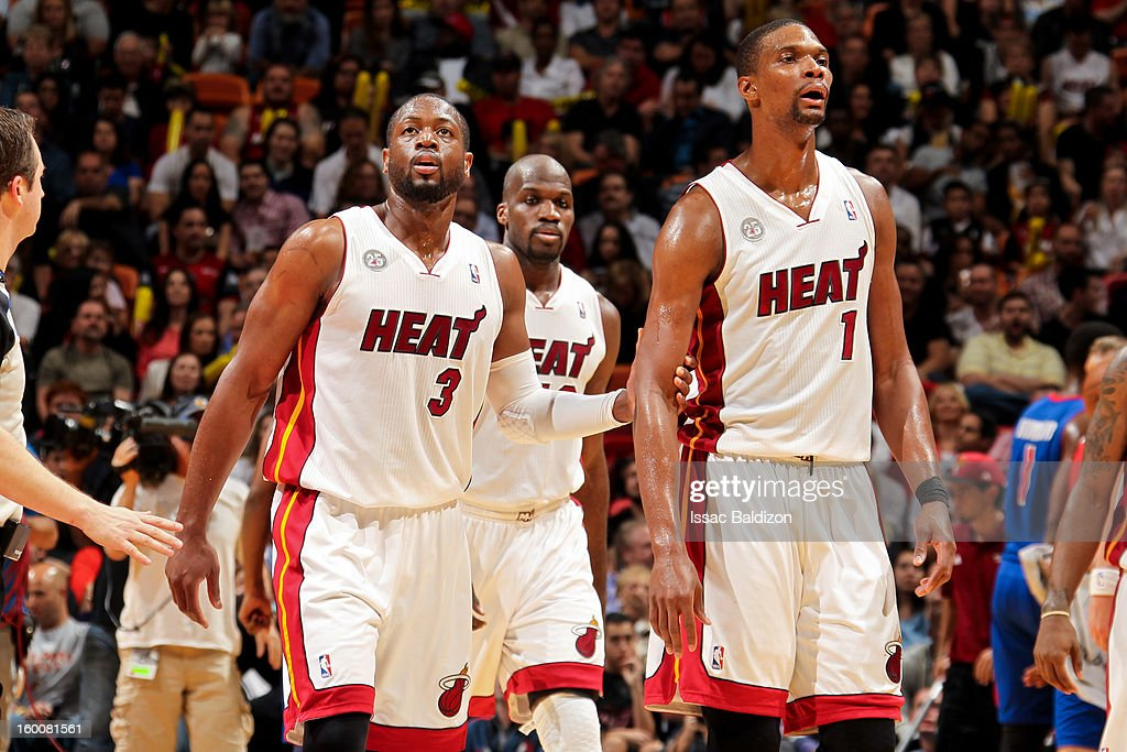 Dwyane Wade #3 of the Miami Heat speaks with teammate Chris Bosh #1 before resuming play against the Detroit Pistons on January 25, 2013 at American Airlines Arena in Miami, Florida.