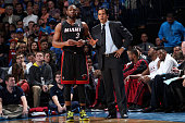 Dwyane Wade of the Miami Heat talks with Head Coach Erik Spoelstra during the game against the Oklahoma City Thunder on February 20 2014 at the...