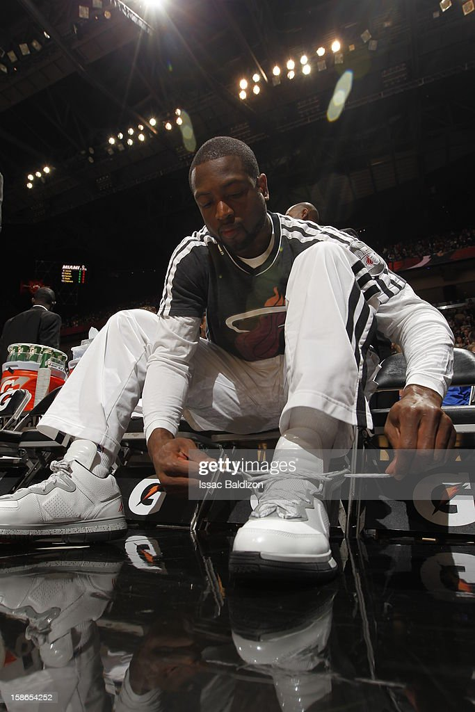 Dwyane Wade #3 of the Miami Heat ties his shoes prior to the game between the Utah Jazz and the Miami Heat on December 22, 2012 at American Airlines Arena in Miami, Florida.