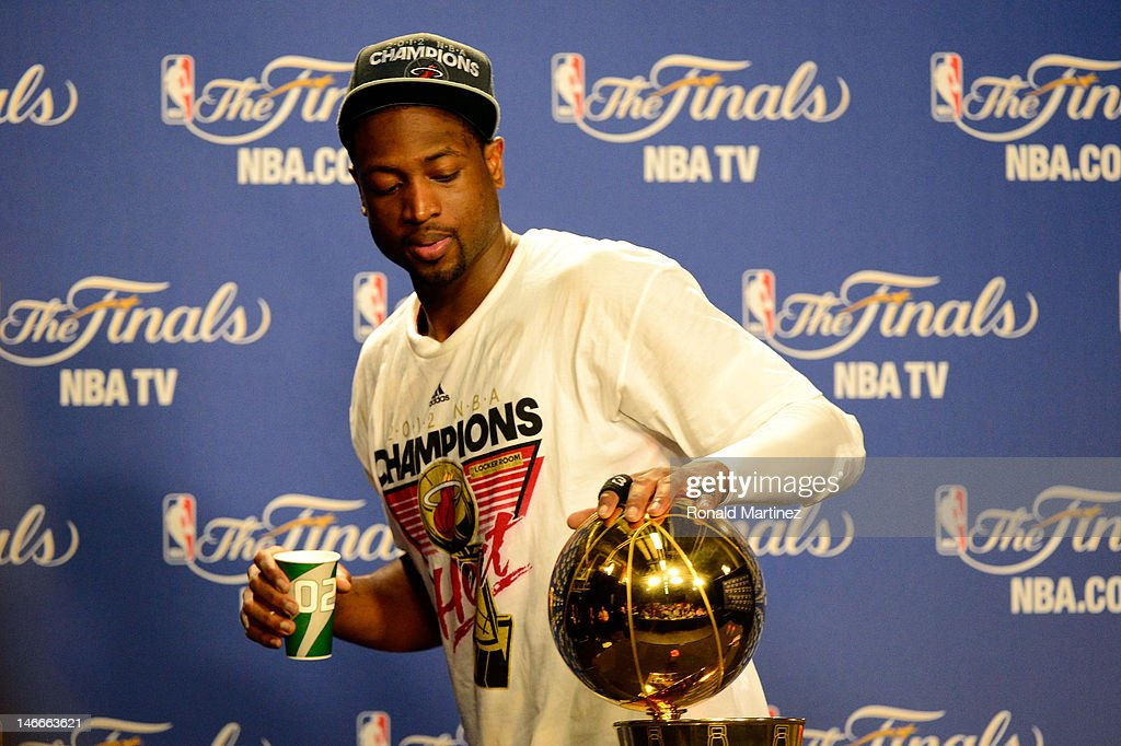 <a gi-track='captionPersonalityLinkClicked' href=/galleries/search?phrase=Dwyane+Wade&family=editorial&specificpeople=201481 ng-click='$event.stopPropagation()'>Dwyane Wade</a> #3 of the Miami Heat touches the Larry O'Brien Finals Championship trophy as he walsk out of his post game press conference after the Heat won 121-106 against the Oklahoma City Thunder in Game Five of the 2012 NBA Finals on June 21, 2012 at American Airlines Arena in Miami, Florida.