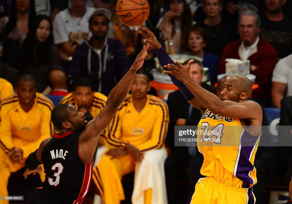 Dwyane Wade (L) of the Miami Heat vies for the ball with Los Angeles Lakers' Kobe Bryant during their NBA game on January 17, 2013 in Los Angeles, California. AFP PHOTO / Frederic J. BROWN