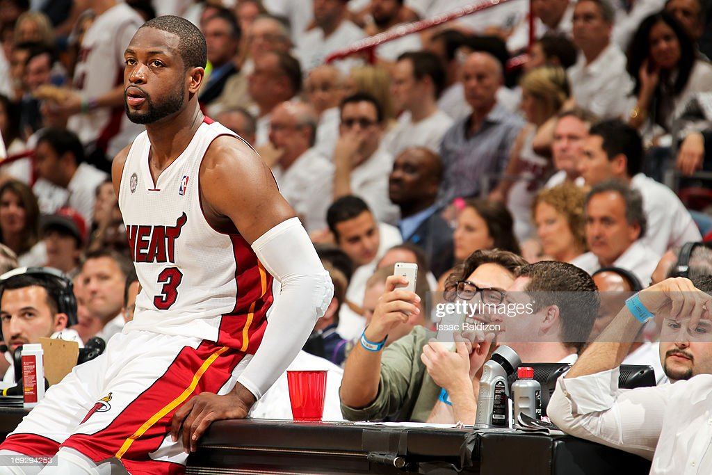 Dwyane Wade #3 of the Miami Heat waits to check back in against the Indiana Pacers in Game One of the Eastern Conference Finals during the 2013 NBA Playoffs on May 22, 2013 at American Airlines Arena in Miami, Florida.