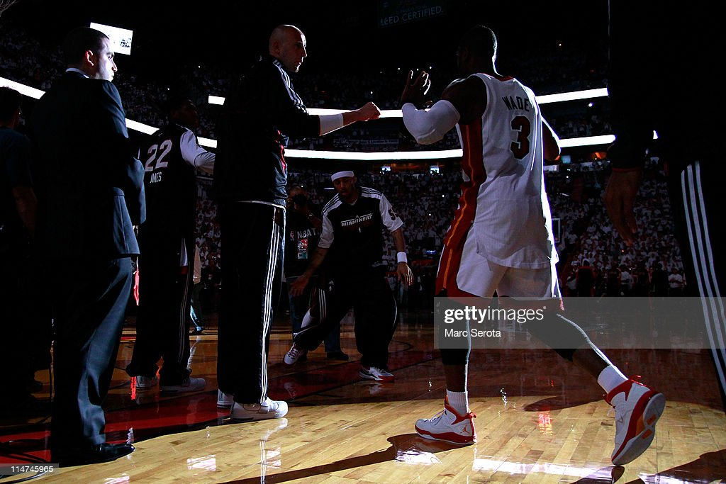 <a gi-track='captionPersonalityLinkClicked' href=/galleries/search?phrase=Dwyane+Wade&family=editorial&specificpeople=201481 ng-click='$event.stopPropagation()'>Dwyane Wade</a> #3 of the Miami Heat walks onto the court during player introductions against the Chicago Bulls in Game Four of the Eastern Conference Finals during the 2011 NBA Playoffs on May 24, 2011 at American Airlines Arena in Miami, Florida.