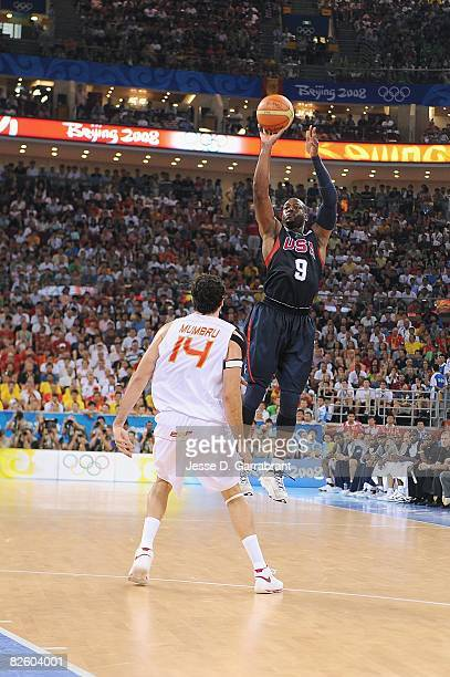 Dwyane Wade of the United States shoots a jumper over Alex Mumbru of Spain during the gold medal game of the 2008 Beijing Summer Olympics at the...
