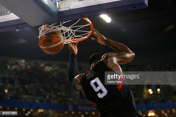 Dwyane Wade of the United States slam dunks in the gold medal game against Spain during Day 16 of the Beijing 2008 Olympic Games at the Beijing...