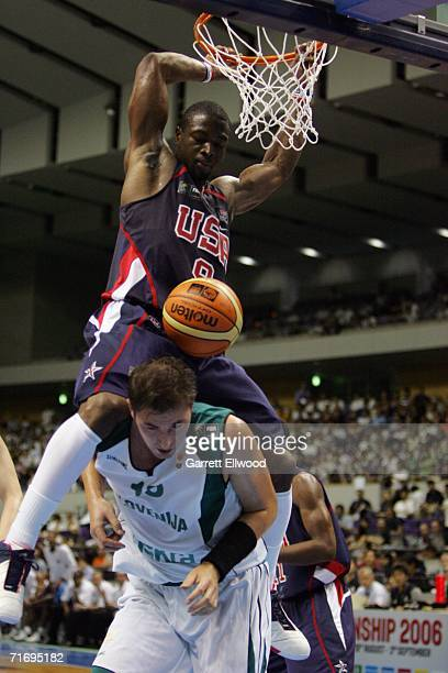 Dwyane Wade of the USA Basketball Senior Men's National Team dunks over Primoz Brezec of Slovenia during the game at the Hokkaido Perfectual Sports...