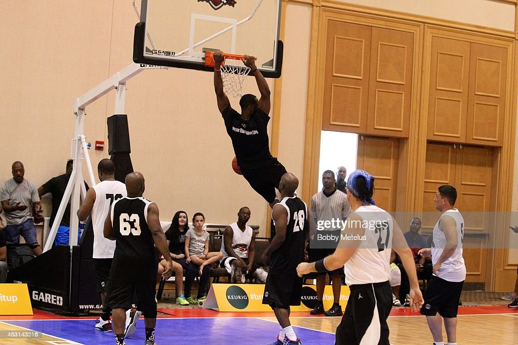 Dwyane Wade plays against campers during Dwyane Wade's Fourth Annual Fantasy Basketball Camp at Westin Diplomat on August 3, 2014 in Hollywood, Florida.