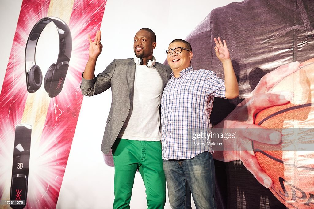 Dwyane Wade poses on stage with a lucky fan at Dwyane Wade's 3-D Headphones Launch Event presented by Fanstang at InTime Mall on July 11, 2013 in Hangzhou, China.