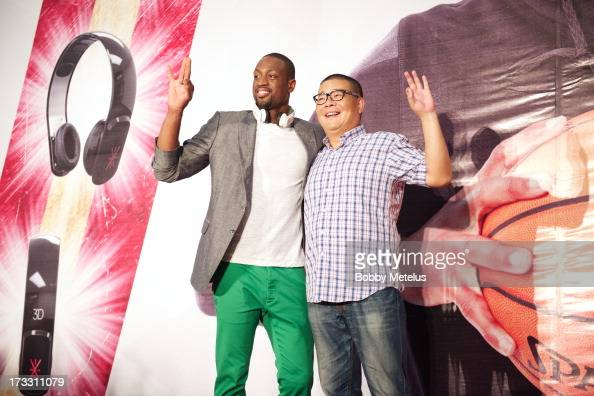 Dwyane Wade poses on stage with a lucky fan at Dwyane Wade's 3D Headphones Launch Event presented by Fanstang at InTime Mall on July 11 2013 in...
