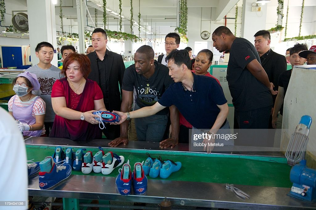 Dwyane Wade receives a tour around the Li-Ning shoe manufacturing factory where his 'Way of Wade' brand is produced on July 12, 2013 in Tai Cang, China. .