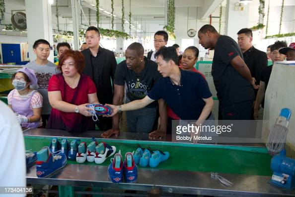 Dwyane Wade receives a tour around the LiNing shoe manufacturing factory where his 'Way of Wade' brand is produced on July 12 2013 in Tai Cang China
