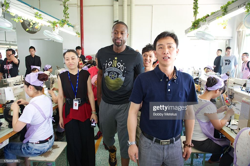 Dwyane Wade receives a tour around the Li-Ning shoe manufacturing factory where his 'Way of Wade' brand is produce on July 12, 2013 in Tai Cang, China. .