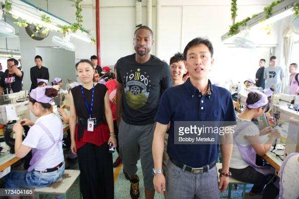 Dwyane Wade receives a tour around the LiNing shoe manufacturing factory where his 'Way of Wade' brand is produce on July 12 2013 in Tai Cang China