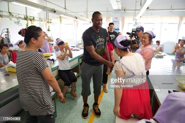 Dwyane Wade shows his appreciation to the factory workers at the LiNing shoe manufacturing factory that works on his 'Way of Wade' shoes and thanks...