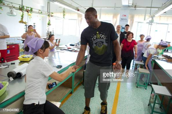 Dwyane Wade shows his appreciation to the factory workers at the LiNing shoe manufacturing factory by shaking everyone's hand that works on his 'Way...