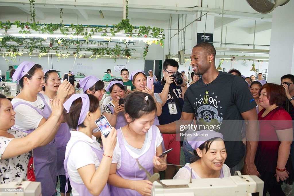 Dwyane Wade shows his appreciation to the factory workers at the Li-Ning shoe manufacturing factory by shaking everyone's hand that works on his 'Way of Wade' shoes and thanking them individually on July 12, 2013 in Tai Cang, China .