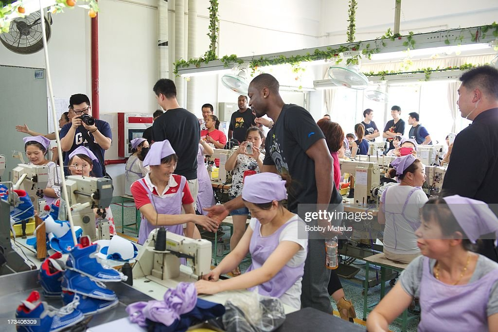 <a gi-track='captionPersonalityLinkClicked' href=/galleries/search?phrase=Dwyane+Wade&family=editorial&specificpeople=201481 ng-click='$event.stopPropagation()'>Dwyane Wade</a> shows his appreciation to the factory workers at the Li-Ning shoe manufacturing factory by shaking everyone's hand that works on his 'Way of Wade' shoes and thanking them individually on July 12, 2013 in Tai Cang, China .