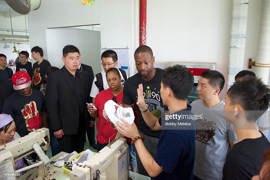Dwyane Wade takes a tour around the Li-Ning shoe manufacturing factory where his 'Way of Wade' brand is produced on July 12, 2013 in Tai Cang, China. .