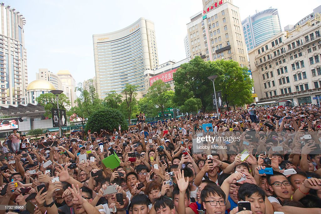 Dwyane Wade (not pictured) waves to a large crowd in front of Li-Ning Flagship store on July 8, 2013 in Shanghai, China .