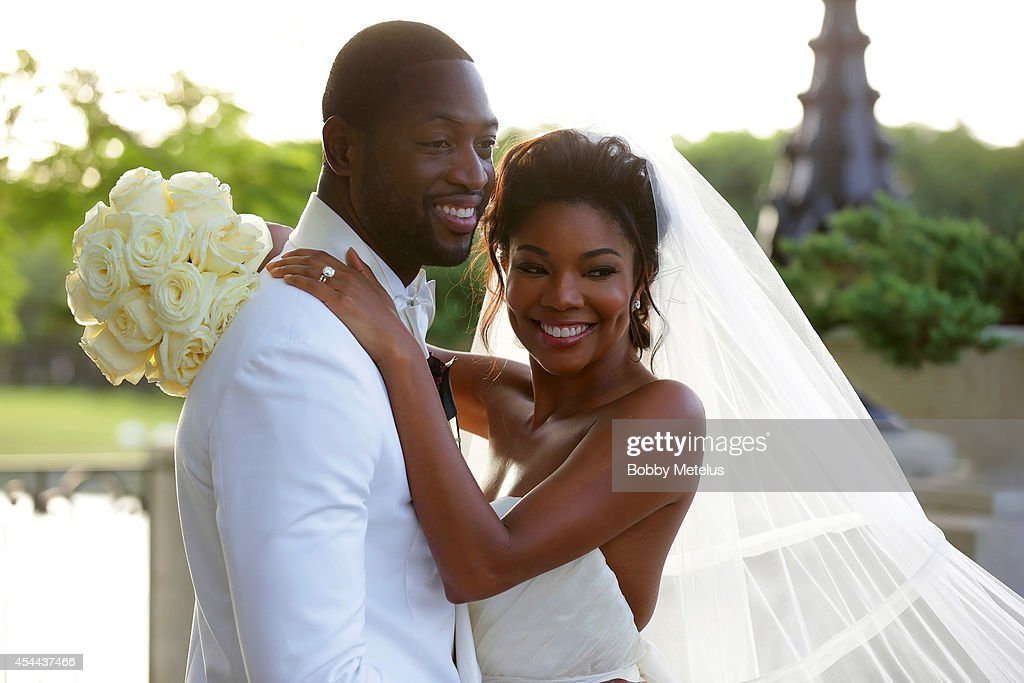 <a gi-track='captionPersonalityLinkClicked' href=/galleries/search?phrase=Dwyane+Wade&family=editorial&specificpeople=201481 ng-click='$event.stopPropagation()'>Dwyane Wade</a>, wearing customized Dsquared2 Tuxedo, his personally designed Wedding Collection bowtie from The Tie Bar and a boutonniere by Floral Fix, and <a gi-track='captionPersonalityLinkClicked' href=/galleries/search?phrase=Gabrielle+Union&family=editorial&specificpeople=202066 ng-click='$event.stopPropagation()'>Gabrielle Union</a>, wearing a Dennis Basso gown pose together in this offcial wedding image on August 30, 2014 in Miami, Florida.