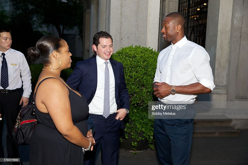 Dwyane Wade with Wade brand business manager Lisa Metelus (L) and Director of Hotel Operations Michael Talansky (C) talk during the SLS Hotels China Branding Launch at the Key Club on July 10, 2013 in Shanghai, China.