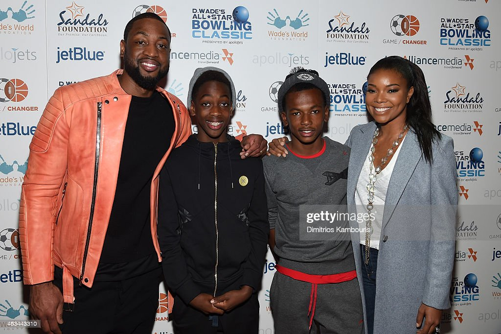 Dwyane Wade Zaire Wade Dahveon Morris and Gabrielle Union attend Dwyane Wade's AllStar Bowling Classic hosted by the Sandals Foundation on February...