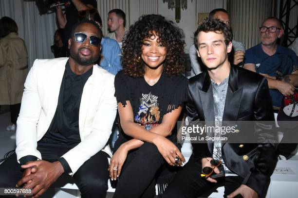 Dwayne WadeGabrielle Union and Brandon Flynn attend the Balmain Menswear Spring/Summer 2018 show as part of Paris Fashion Week on June 24 2017 in...