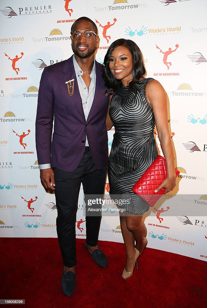 Dwyanw Wade and <a gi-track='captionPersonalityLinkClicked' href=/galleries/search?phrase=Gabrielle+Union&family=editorial&specificpeople=202066 ng-click='$event.stopPropagation()'>Gabrielle Union</a> make an appearance as Premier Beverage Hosts Art Of Basketball: Heat Wave With <a gi-track='captionPersonalityLinkClicked' href=/galleries/search?phrase=Dwyane+Wade&family=editorial&specificpeople=201481 ng-click='$event.stopPropagation()'>Dwyane Wade</a> & Chris Bosh on December 7, 2012 in Miami, Florida.