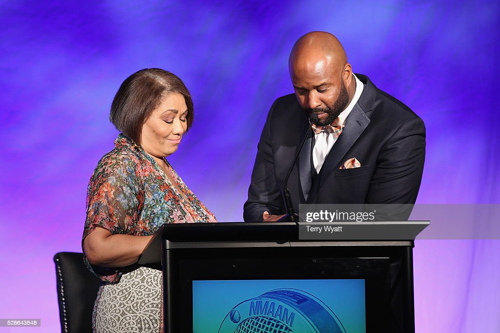 Dyana Williams and Shannon Sanders speak onstage during NMAAM's Celebration Of Legends Red Carpet And Luncheon on May 6, 2016 in Nashville, Tennessee.