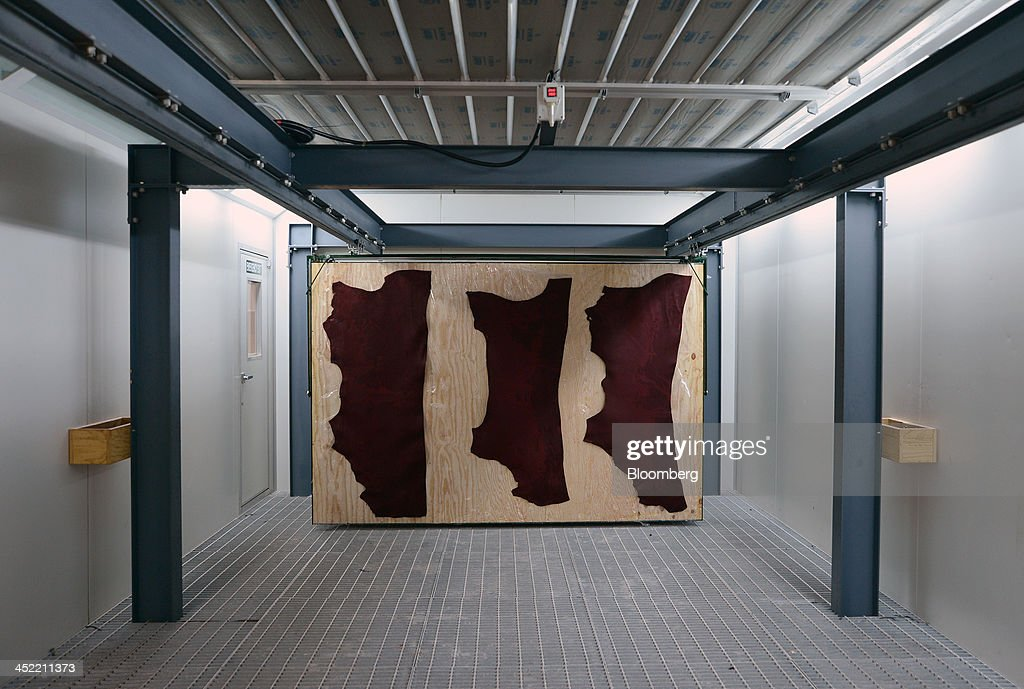 Dyed cow hides used for making cricket balls hang to dry at the Kookaburra Sports Pty Ltd. plant in Melbourne, Australia, on Tuesday, Nov. 26, 2013. Australian businesses need to boost efficiency to maintain growth in living standards, Reserve Bank of Australia Deputy Governor Philip Lowe said. Photographer: Carla Gottgens/Bloomberg via Getty Images