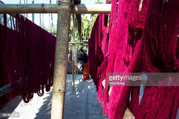 Dyed Eri silk threads hang from bamboo poles as it dries at a house in Udalgudi Assam India on Wednesday Jan 14 2015 The Sensex last week had its...