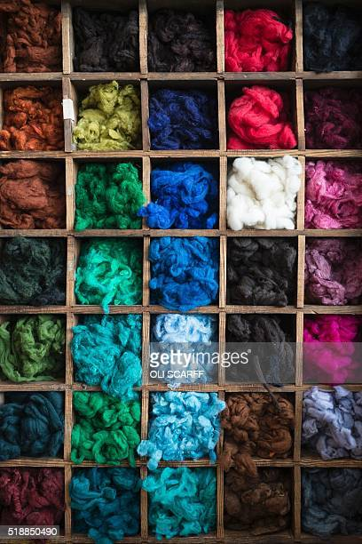 Dyed wool produced by Abraham Moon and Sons woollen mill is on display at the factory shop in Guiseley northern England on March 30 2016 Abraham Moon...