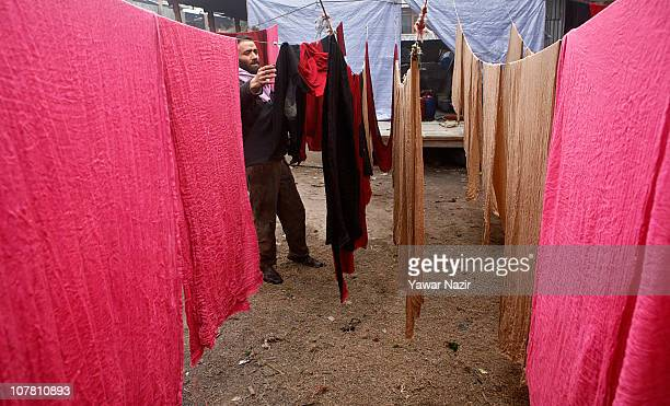 A dyer dyes pashmina shawls at his workshop on December 29 2010 in the outskirts of Srinagar the summer capital of Indian administered Kashmir India...